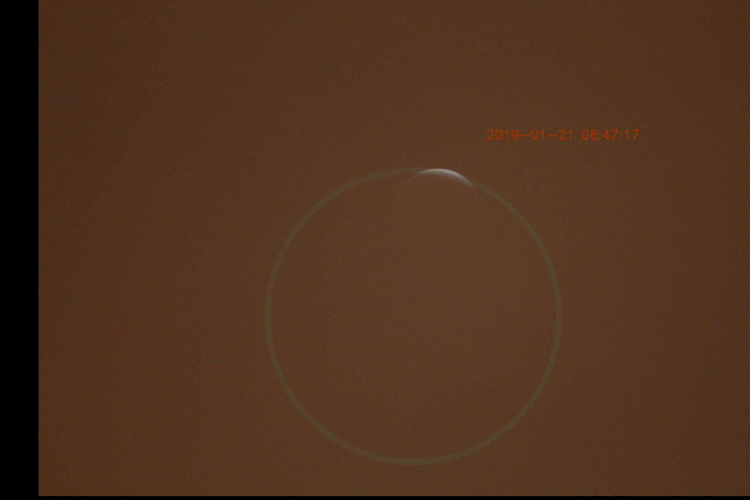 Ende der Totalität (man erkennt die nachträgliche Bildverschiebung am schwarzen Rand links und unten)